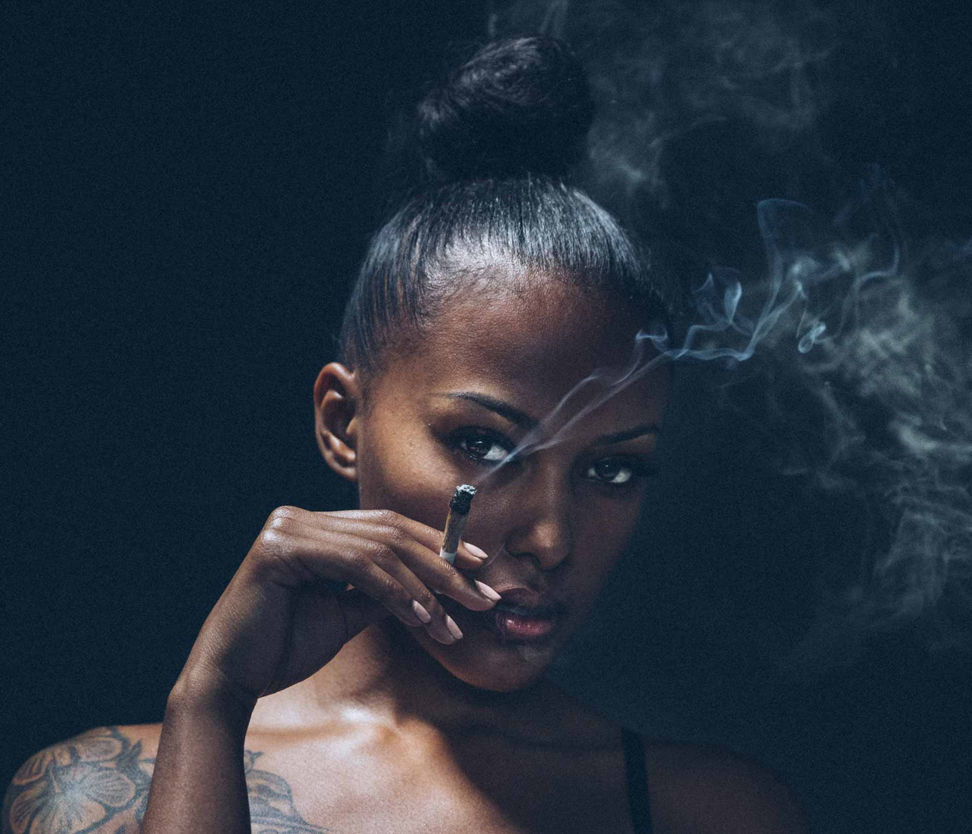Woman smoking Kushy Dreams
